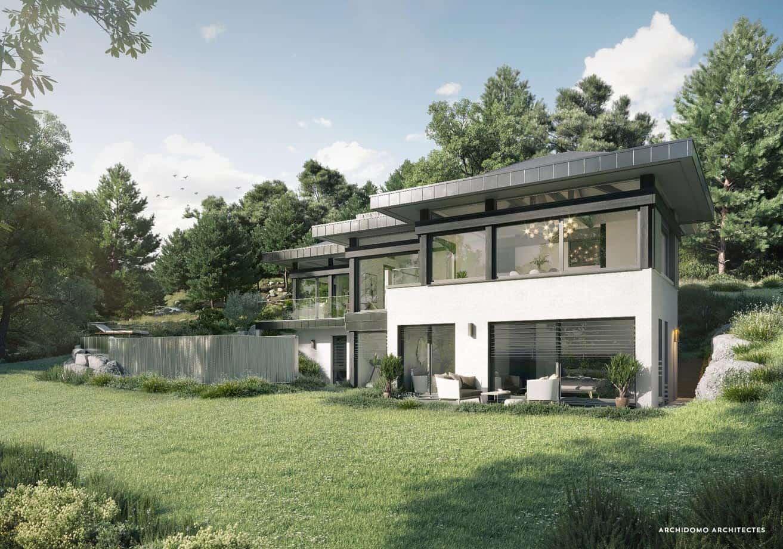 Vue d'une magnifique maison contemporaine posée dans un écrin de verdure. Maison contemporaine, constructeur maison - Maison d'architecte - Maison Particulière - Haute-Savoie - 74